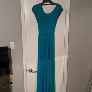 Turquoise maxi with criss cross cut out in back.